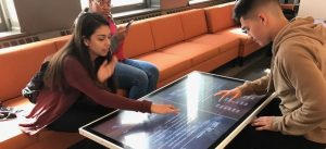 Two high school students on a field trip play a game at the Word Play tables at the American Writers Museum in Chicago, IL
