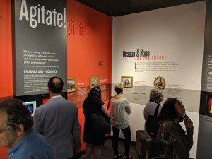 Visitors exploring Frederick Douglass: Agitator exhibit at the American Writers Museum