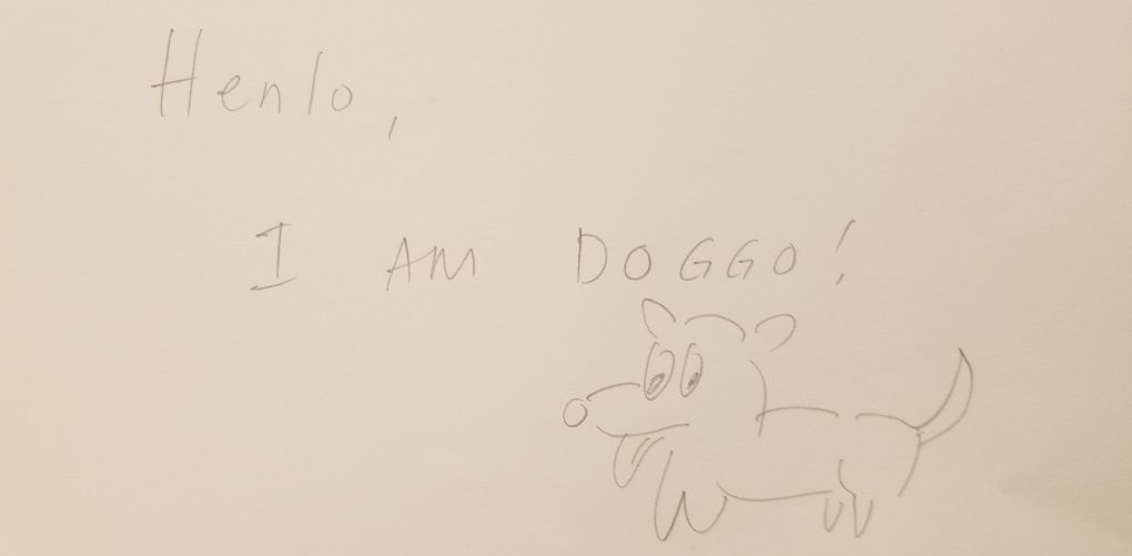 "A drawing of a dog and text that say ""Henlo, I am doggo."" Drawn by a visitor at the Story of the Day exhibit at the American Writers Museum in Chicago, Illinois"