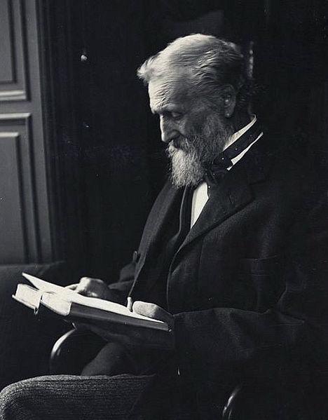 Photo of John Muir reading a book