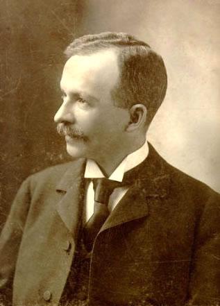 Sepia photo of Charles Chesnutt facing left.
