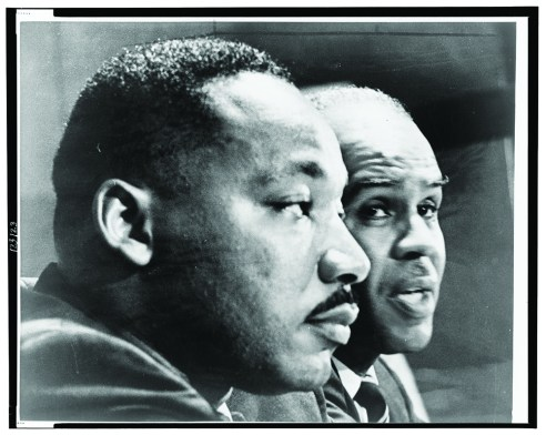1964, Dr. Martin Luther King, bust portrait, seated, facing right, next to Roy Wilkins of the NAACP. New York World-Telegram and the Sun Newspaper Photograph Collection, Prints and Photographs Division