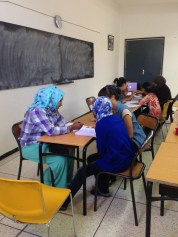 Intermediate Students working together on grammar lessons at the Azrou Center.