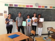 Our advanced class showing off the travel brochures they made for homework.