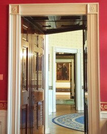 Painting of George Washington seen from the State Dining Room through several doorways at the White House