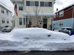 Car covered in snow during a snow emergency at Somerville MA