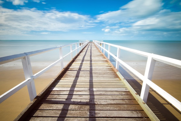 beach pier dock ocean white light