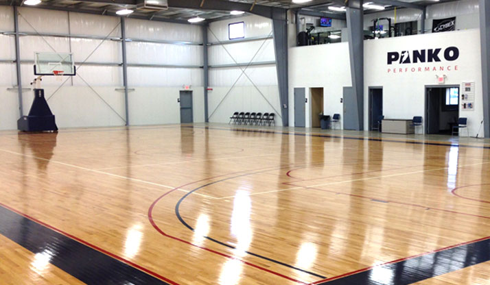 Shiny clean basketball court at Panko Performance facility.