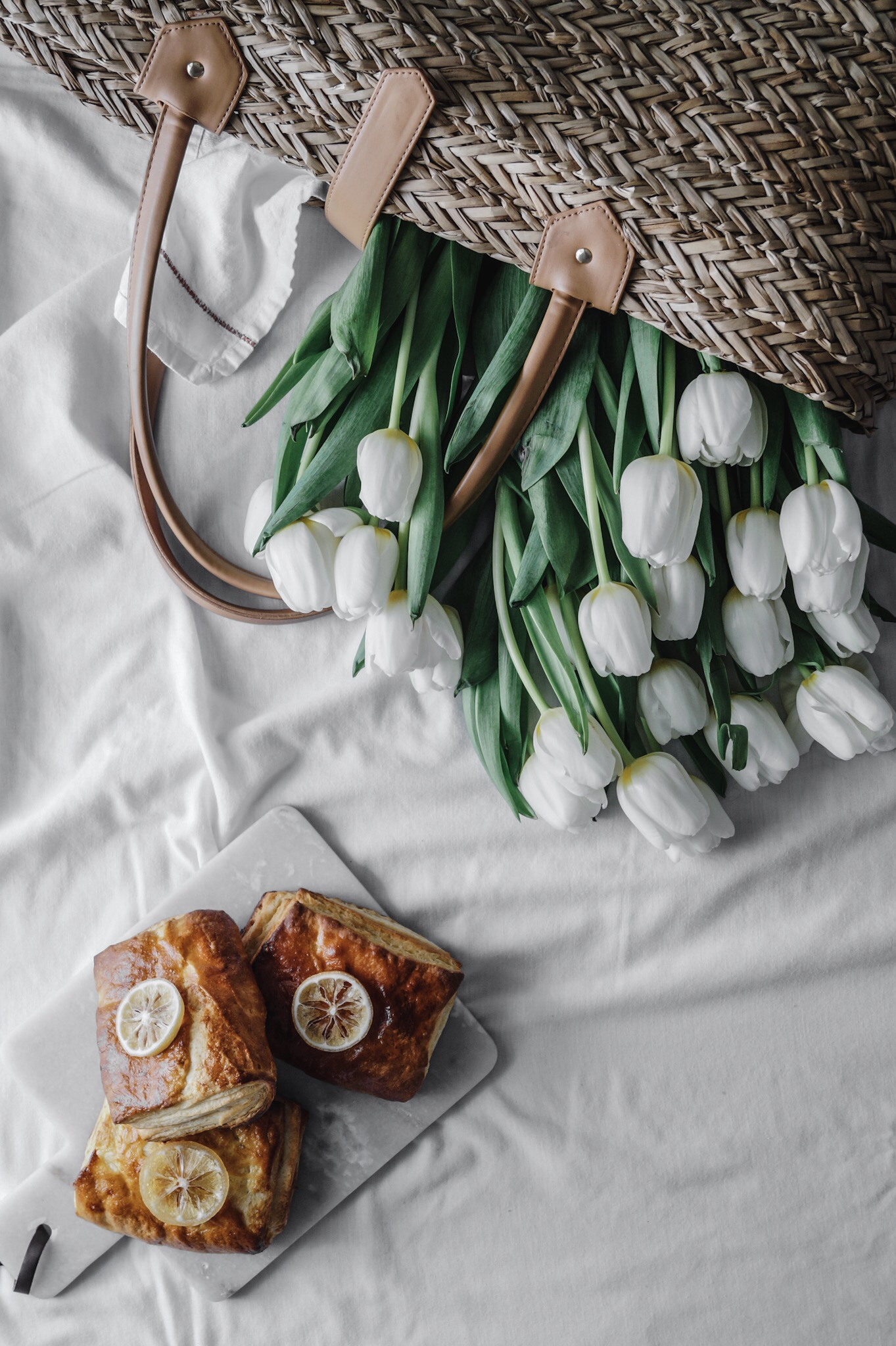 Super bright lemony filling tucked neatly inside the most delicious crispy-flaky Danish pastry. A early spring picnic and a wild story about boys. Spring tulips and an indoor picnic brunch by A Messy Bun Kitchen
