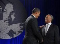 US President Barack Obama greets Rev Al