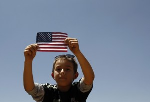 A boy listens to U.S. President Barack Obama speak on immigration reform at Chamizal National Memorial Park in El Paso