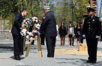 US President Barack Obama lays a wreath