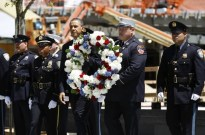 President Obama carries a wreath accompanied by New York City firefighters and NYPD police officers at the World Trade Center site in New York