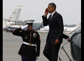 U.S. President Barack Obama salutes as he arrives at Dover Air Force Base in Delaware aboard Marine One