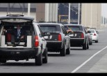Motorcade carrying U.S. President Obama drives at Dover Air Force Base in Delaware