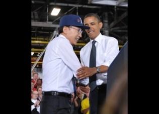 US President Barack Obama shakes hands w