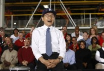 South Korean President Lee laughs during remarks while wearing Detroit Tigers baseball cap during his tour of General Motors Orion Assembly with U.S. President Obama in Detroit