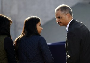 Eric Holder arrives with his family at the Martin Luther King, Jr. memorial dedication ceremony of the National Memorial in Washington