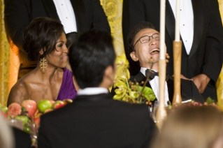 South Korean President Lee Myung-bak laughs next to U.S. first lady Michelle Obama during a state dinner at the White House