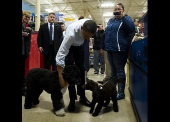 US President Barack Obama holds on to th
