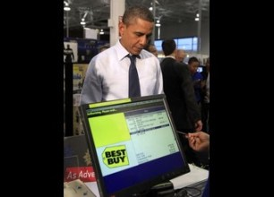 U.S. President Barack Obama makes a purchase at Best Buy in Alexandria