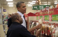U.S. President Barack Obama selects a bone for his dog Bo at a pet store in Alexandria