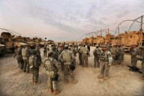 Soldiers from the 3rd Brigade, 1st Cavalry Division, wait to start an internal patrol at Camp Adder, now known as Imam Ali Base, near Nasiriyah, Iraq