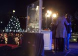U.S. President Obama speaks as his family watch during the lighting of the National Christmas Tree in Washington