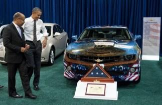 US President Barack Obama talks with Ed