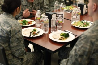 Plates sit in front of airmen during the visit of U.S. First Lady Michelle Obama to a dining facility at Little Rock Air Force Base in Arkansas