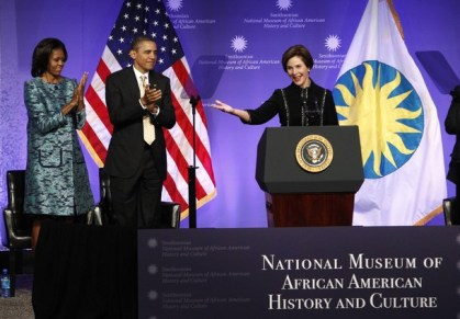 U.S. President Obama and first lady Michelle applaud former first lady Bush as she speaks at the ground breaking ceremony for the Smithsonian National Museum of African American History and Culture in Washington