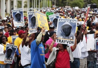 Demonstrators march during an NAACP march and rally to the front of the Sanford Police Department for Trayvon Martin in Sanford, Florida