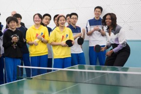 Forbidden City29-First Lady Michelle Obama plays ping pong with students while touring the Beijing Normal School in Beijing, China, March 21, 2014. Official White House Photo by Amanda Lucidon