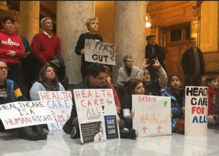 Around 500 people took to the Indiana Statehouse Jan. 15 to protest president-elect Donald Trump's plans to repeal the Affordable Care Act, which insures around 20 million people in the U.S. (Photo: Kara Berg/ IndyStar)