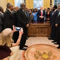 Photo: Kellyanne Conway kneeling on Oval Office couch