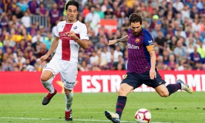 C Barcelona's Lionel Messi (R) in action against Huesca's Xabier Etxeita (L) during the Spanish La Liga soccer match between FC Barcelona and SD Huesca at Camp Nou in Barcelona, Spain, 02 September 2018. EPA/MARTA PEREZ