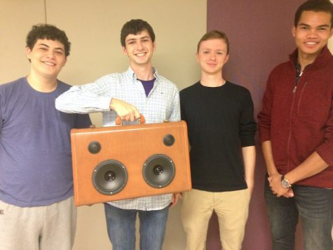 The InCase poses with their speaker. From left: Toby Cashook, Aidan MacBain, Ian Birle and Pandeni Idhenga.