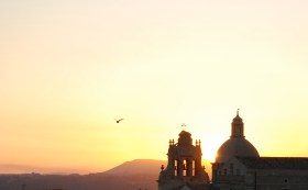 View of the sunset through the San Michele Arcangelo church of Grammichele