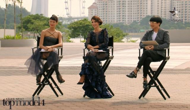 The new judging panel deliberating the girls' fierce(?) walks.