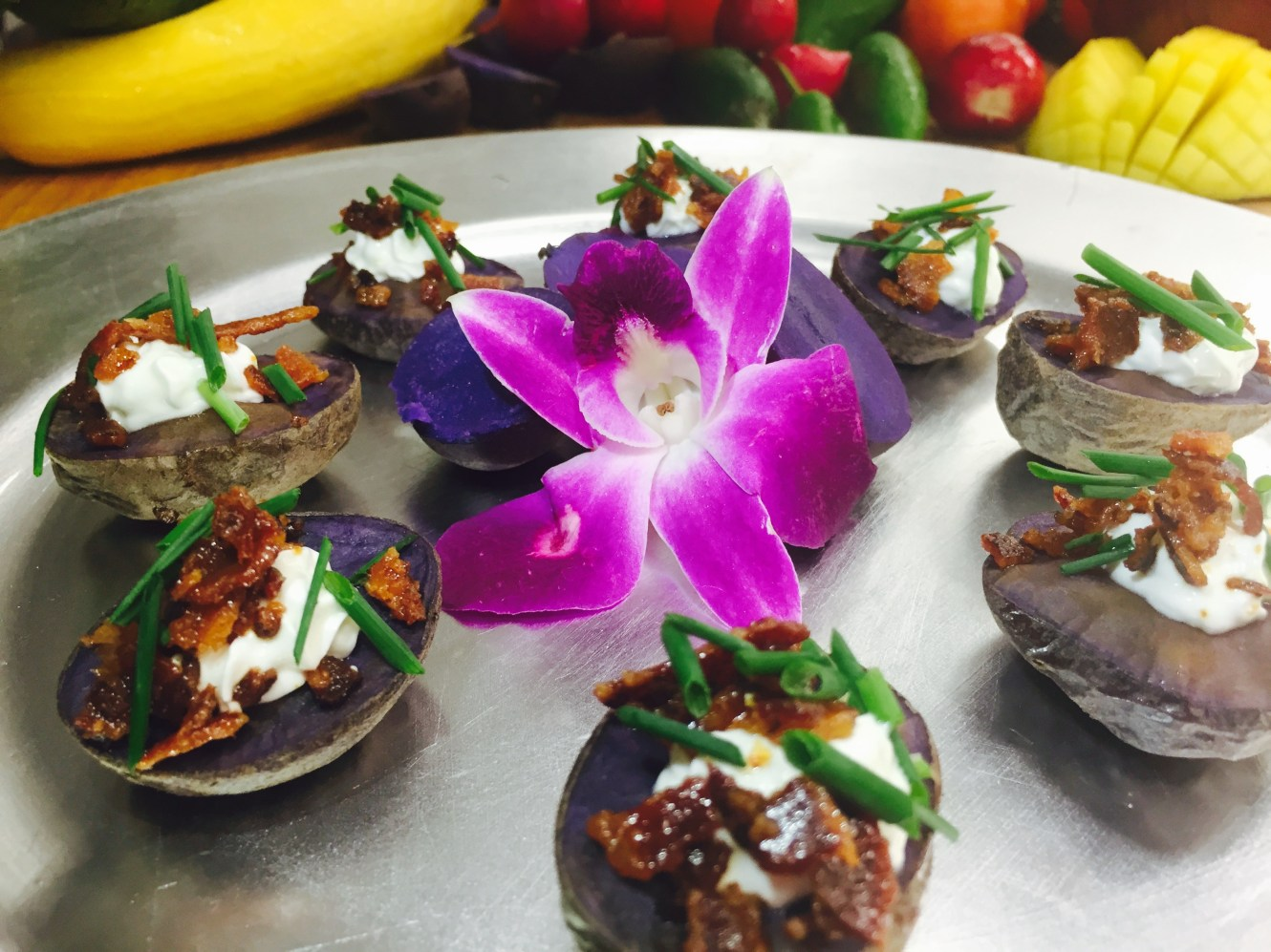 Mini Baked Purple Potatoes with Sour Cream, Bacon and Chives