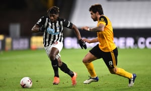 Alan Saint-Maximin of Newcastle is challenged by Robin Neves.
