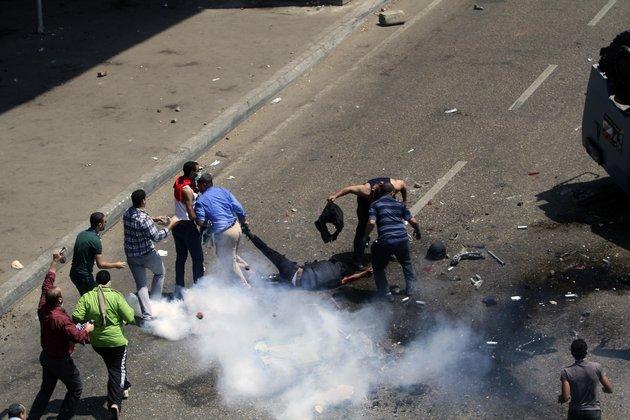 Protesters savage hapless injured policeman