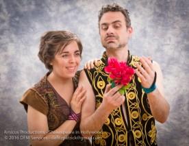 Oberon (Chris Coculuzzi) instructs Puck (Kristine MacDonald) on the art of the magic flower