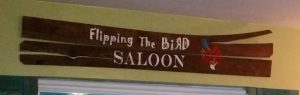 amigas4all wood sign flipping the bird saloon