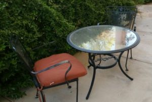 amigas4all spray painted table trash backyard