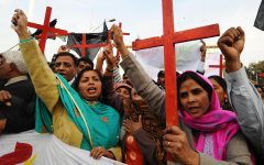 Members of the Pakistan Christian Democratic alliance march during a protest in Lahore on December 25, 2010, in support of Asia Bibi, a Christian mother sentenced to death under blasphemy laws.  Bibi was arrested in June 2009 after Muslim women labourers refused to drink from a bowl of water she was asked to fetch while out working in the fields. Days later, the women complained that she made derogatory remarks about the Prophet Mohammed. Bibi was set upon by a mob, arrested by police and sentenced on November 8.  AFP PHOTO/Arif ALI (Photo credit should read Arif Ali/AFP/Getty Images)
