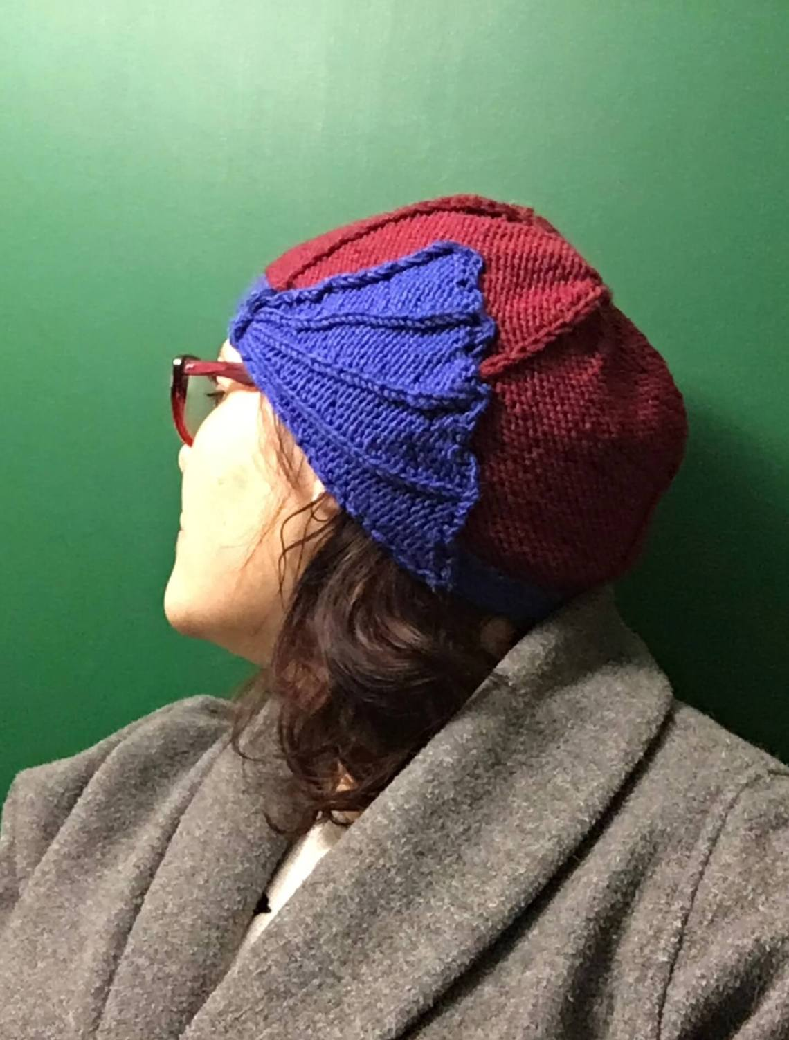 showing of the art deco styling of this knitted hat