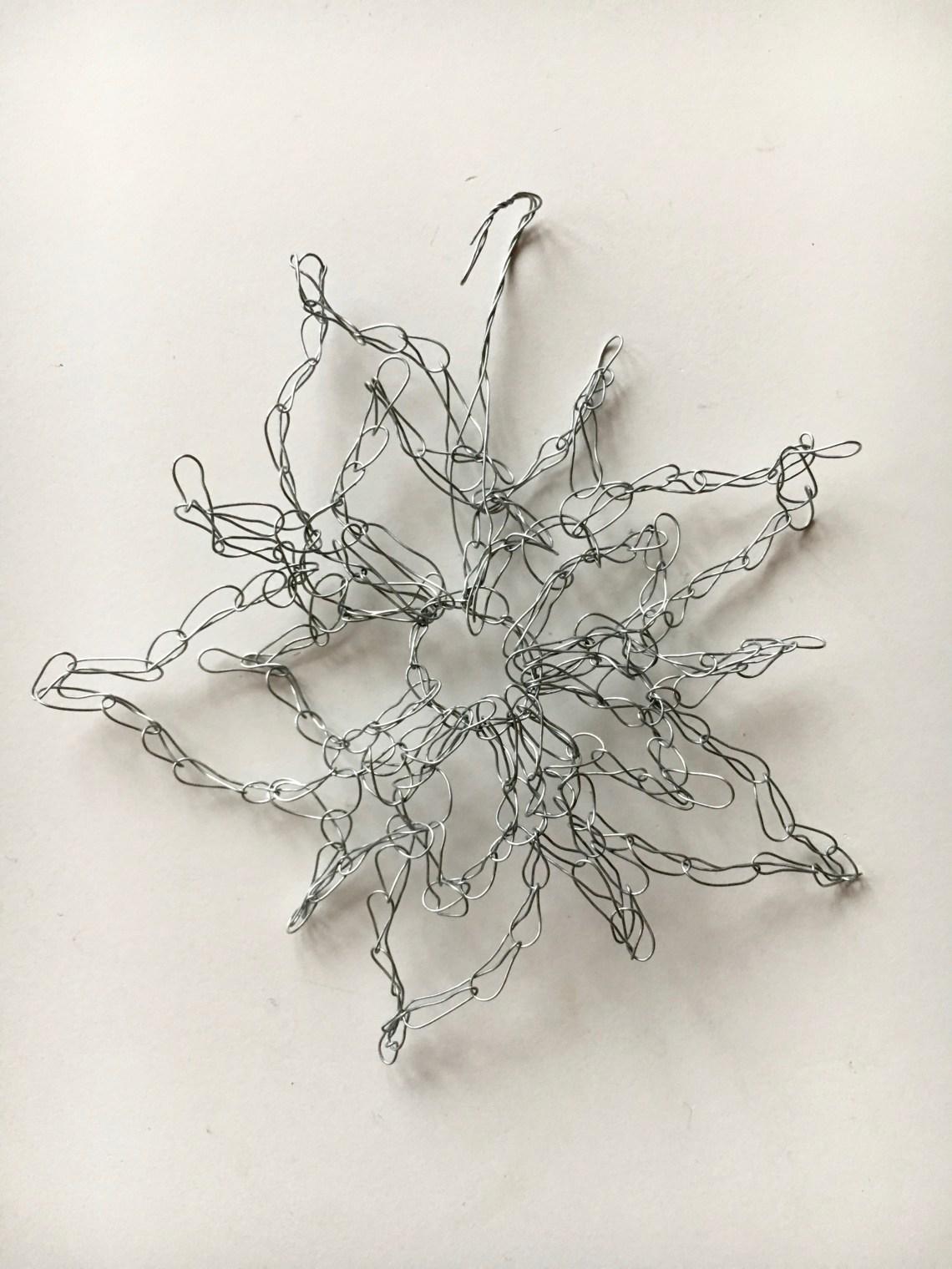 Elaborate crochet snowflake pattern