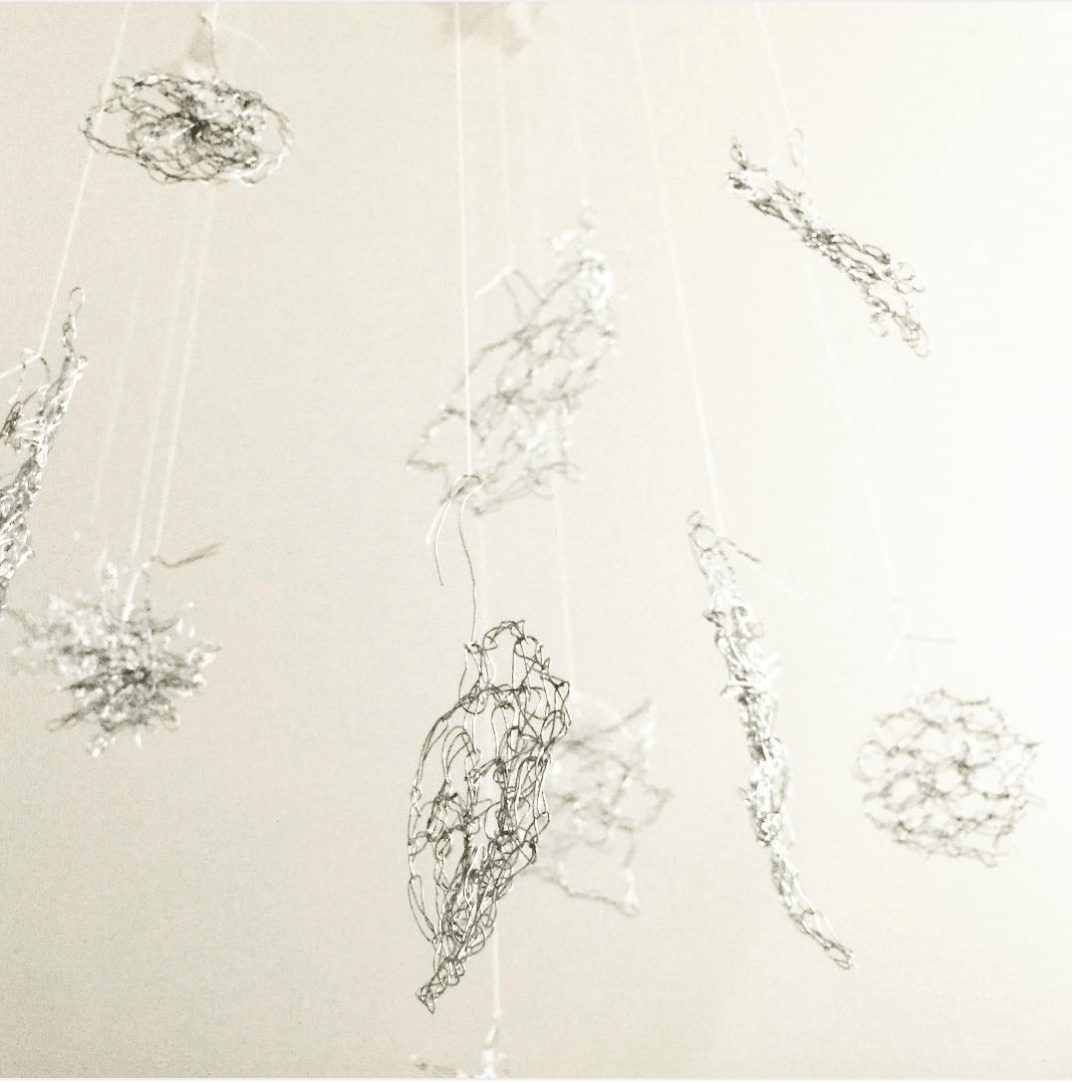 crocheted snowflakes made of wire