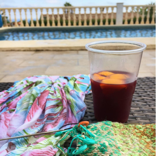 knitting and drinking in the sun!